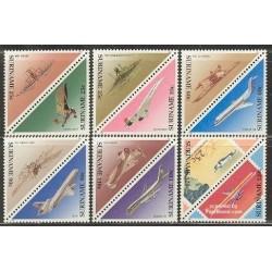 12 عدد تمبر مثلثی هواپیماها - سورینام 1987
